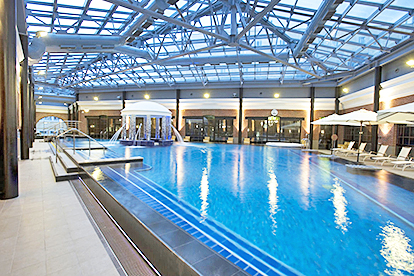 Indoor swimming Pool, under glass ceiling, Palace Bridge Hotel St. Petersburg